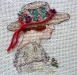 Serinde – Woman with Floral Hat Miniature